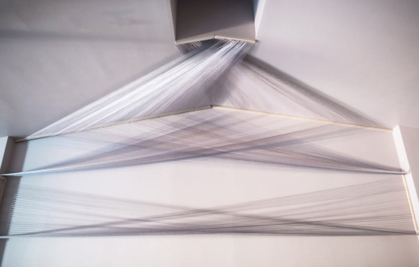 """Pyramidal Planes, 79"""" x 212"""" x 69"""", (2014) Polyester and rayon thread hand strung on site; maple"""
