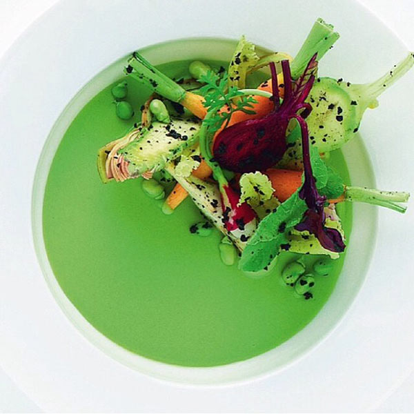 Baby vegetables: radish, carrots, purple artichoke, peas, and truffle with a tender pea condiment by chef Alain Ducasse from France