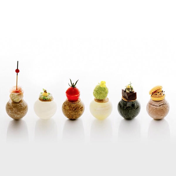 Mini-menu starters. From left to right: 1. Room temperature stone: amuse-bouche - 2. Chilled stone: Minced vegetables with trout roe - 3. Room temperature stone: Tomato gazpacho - 4. Hot stone: Fish croquette - 5. Warm stone: Beef gelée - 6. Cold stone: Not too sweet macaron by chef Noriyuki Hamada of Bleston Court Yukawatan from Japan