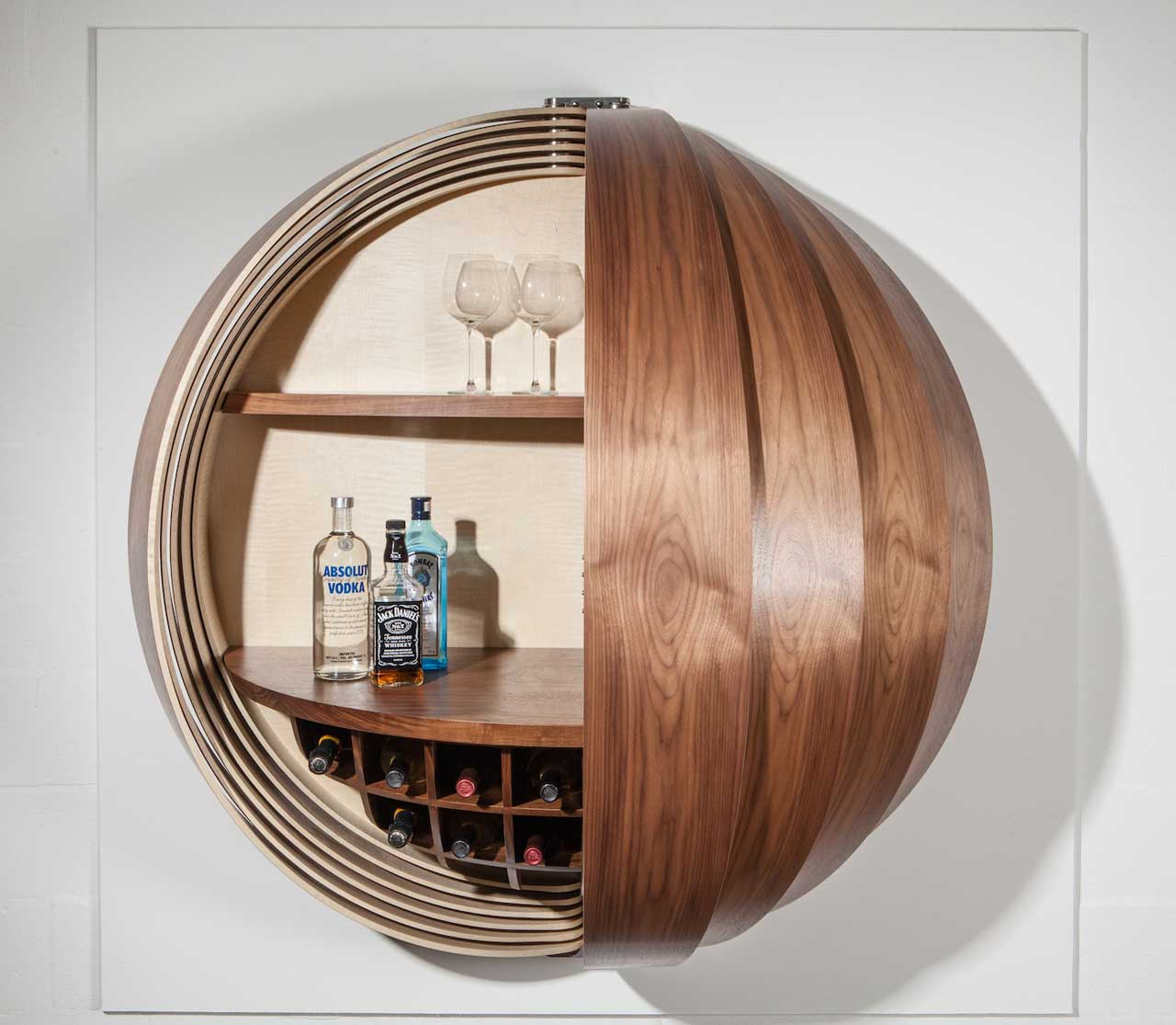 A Wall-Mounted Bar Cabinet Inspired by a Spinning Coin - Design Milk