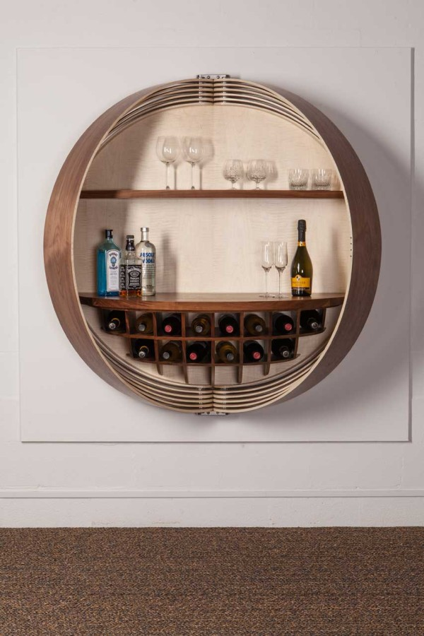 a wall mounted bar cabinet inspired by a spinning coin 86919