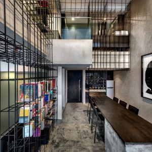 Apartment Unified by a Giant Cage