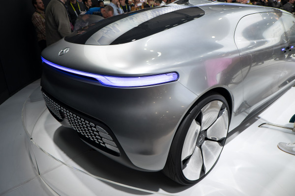A muscular rear is defined by the strong horizontal of LED lights and a inky capsule window which flows upward to a subtle fin, where the autonomous driving system is housed.