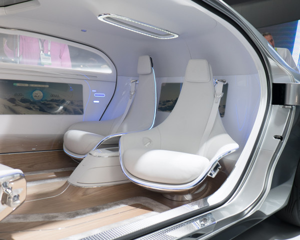 Ironically, it was the pre-industrial horse-drawn carriage which heavily influenced this future-forward, tech-laden interior, arguably the most unusual automotive seating arrangement since Trevor Fiore's more angular, Citroën Karin.