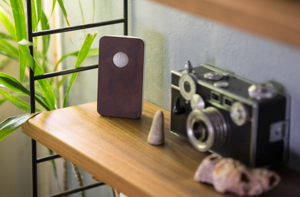 The walnut finish motion sensor resides on a bookshelf, relatively inconspicuous while keeping tabs on the comings and goings of occupants of our apartment living room.