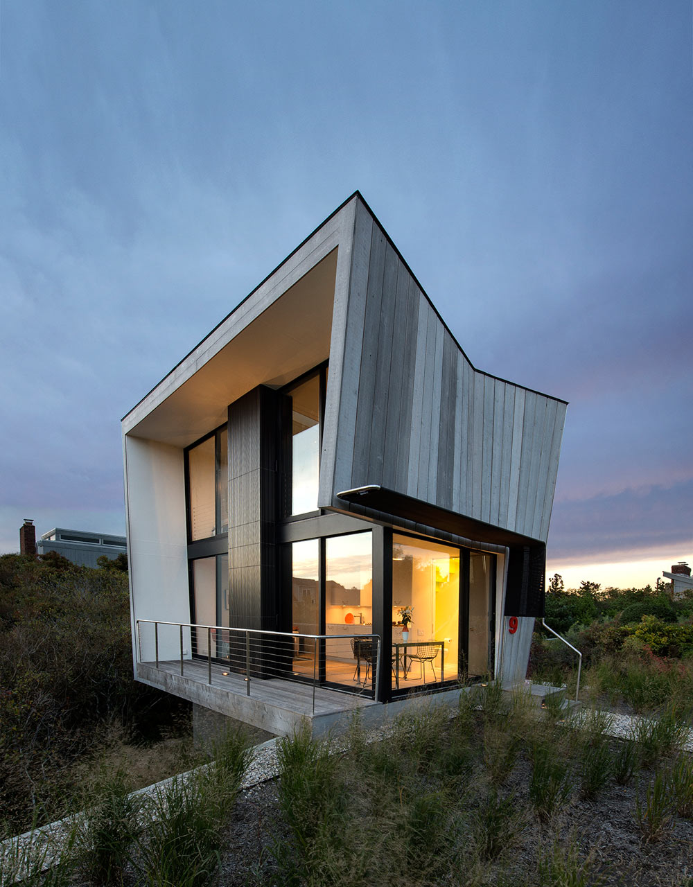 A Two-Story Beach House with a Small Footprint