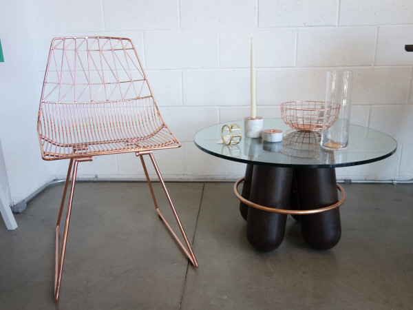 Copper chair by Bend Design, Bolt Stool by La Chance (which they transformed into a table), and tableware by Menu, Umbra Shift and Hay