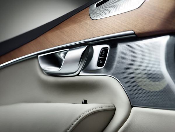 The XC90's interior cabin is a harmonious confluence of warm wood veneer, the cool touch of metal, and premium leather (seat firmness adjustable by the touch of a button).  Leather stitching, surrounding wood grain, and the perforations dotted across the speaker grill all invite a directional flow both visually and with the tactile experience in mind.