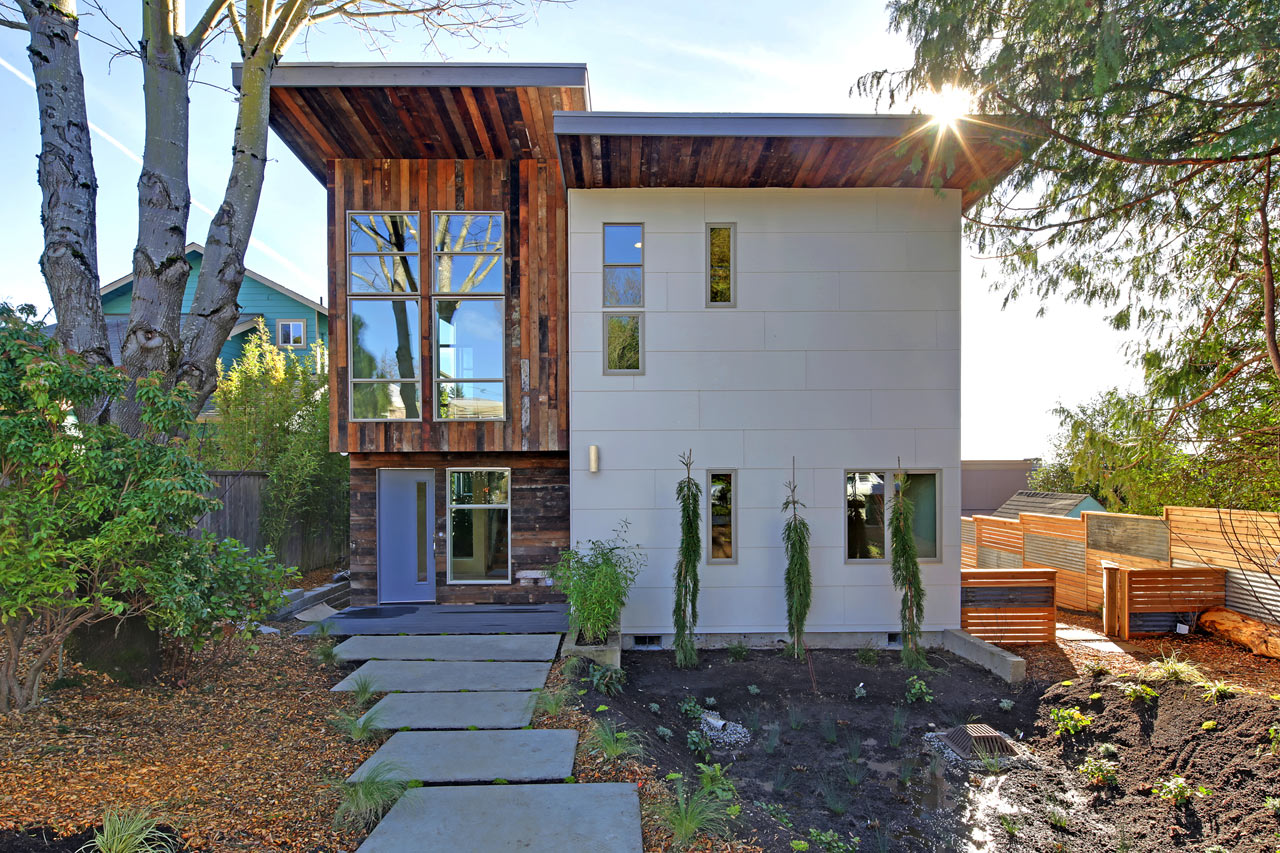 Home uses sustainable reclaimed materials design milk for Reclaimed house materials
