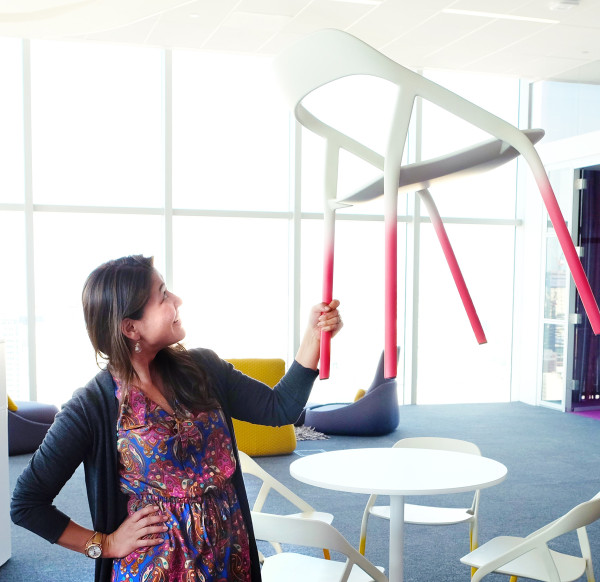 Steelcase's Danielle Razo shows off the lightweight construction of an upcoming guest chair.