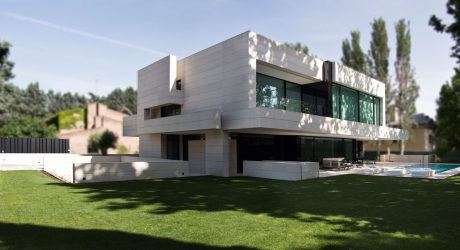 A Madrid Home Clad in Limestone and Black Glass