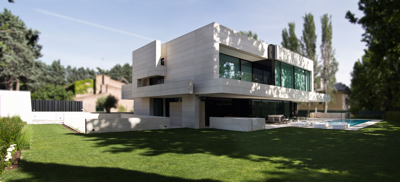 Modern home made of limestone black glass design milk for Limestone homes designs