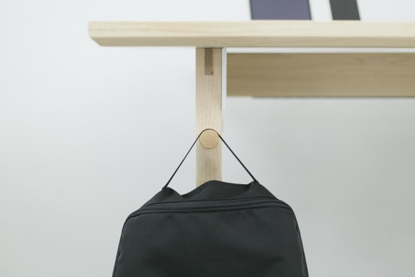"""Thoughtful detailing like this peg for bags,  headphones and other accessories should endear the desk to those who believe in """"a place for everything, everything in its place""""."""