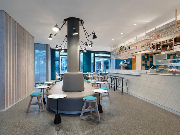popular cafe gets revamped for many functions design milk. Black Bedroom Furniture Sets. Home Design Ideas