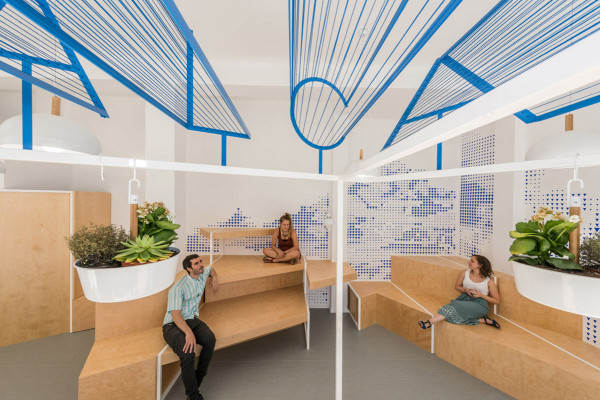 a modern tourist office in spain featuring cool graphic With interior design tourism office