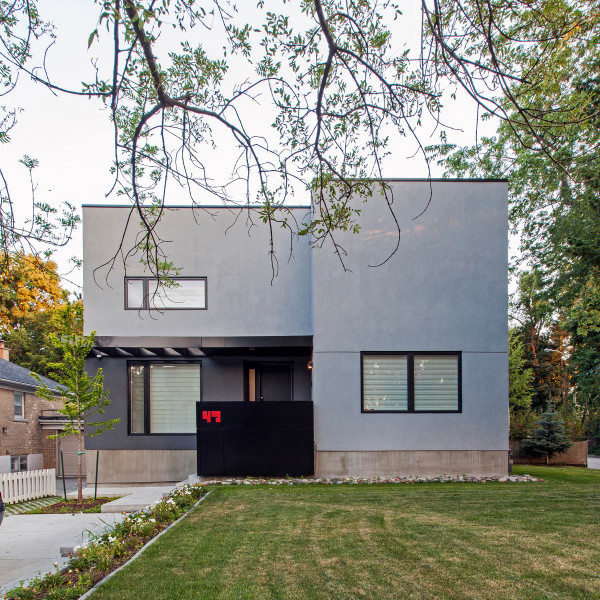 A Bungalow is Replaced with a Minimalist, Two-Story House