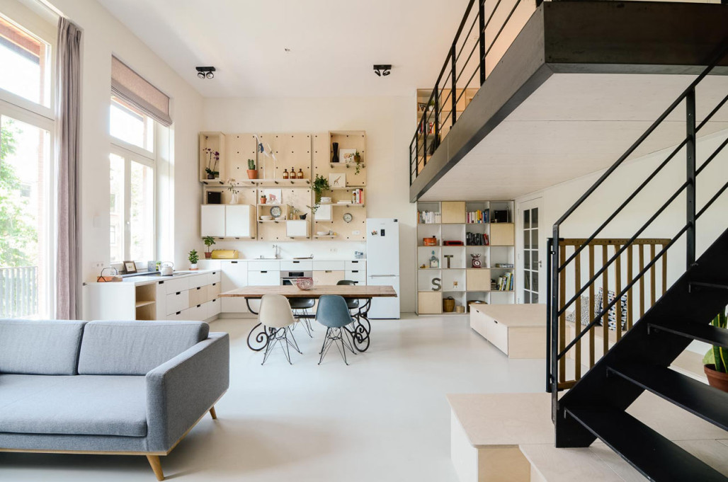 An old school is converted into a new apartment design milk for Product design studio