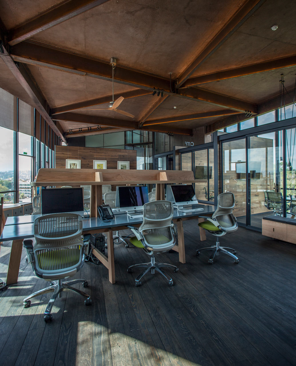 An Irregularly Shaped Office That Sits Above the Treetops
