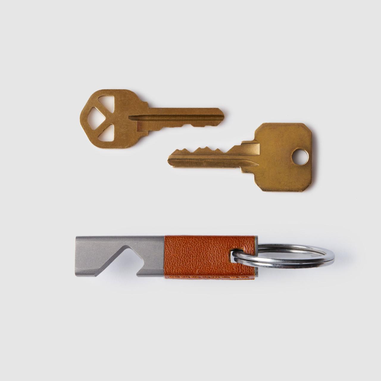 octovo the bottle opener keychain titanium leather propped design milk. Black Bedroom Furniture Sets. Home Design Ideas