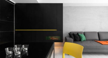 A Black & White Apartment with Yellow Accents