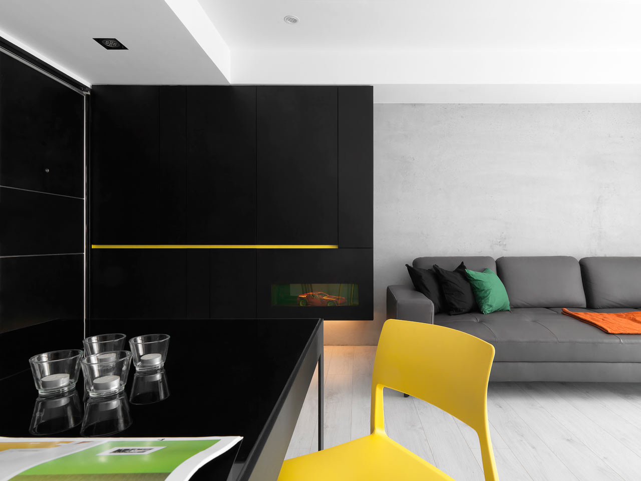 a black & white apartment with yellow accents - design milk