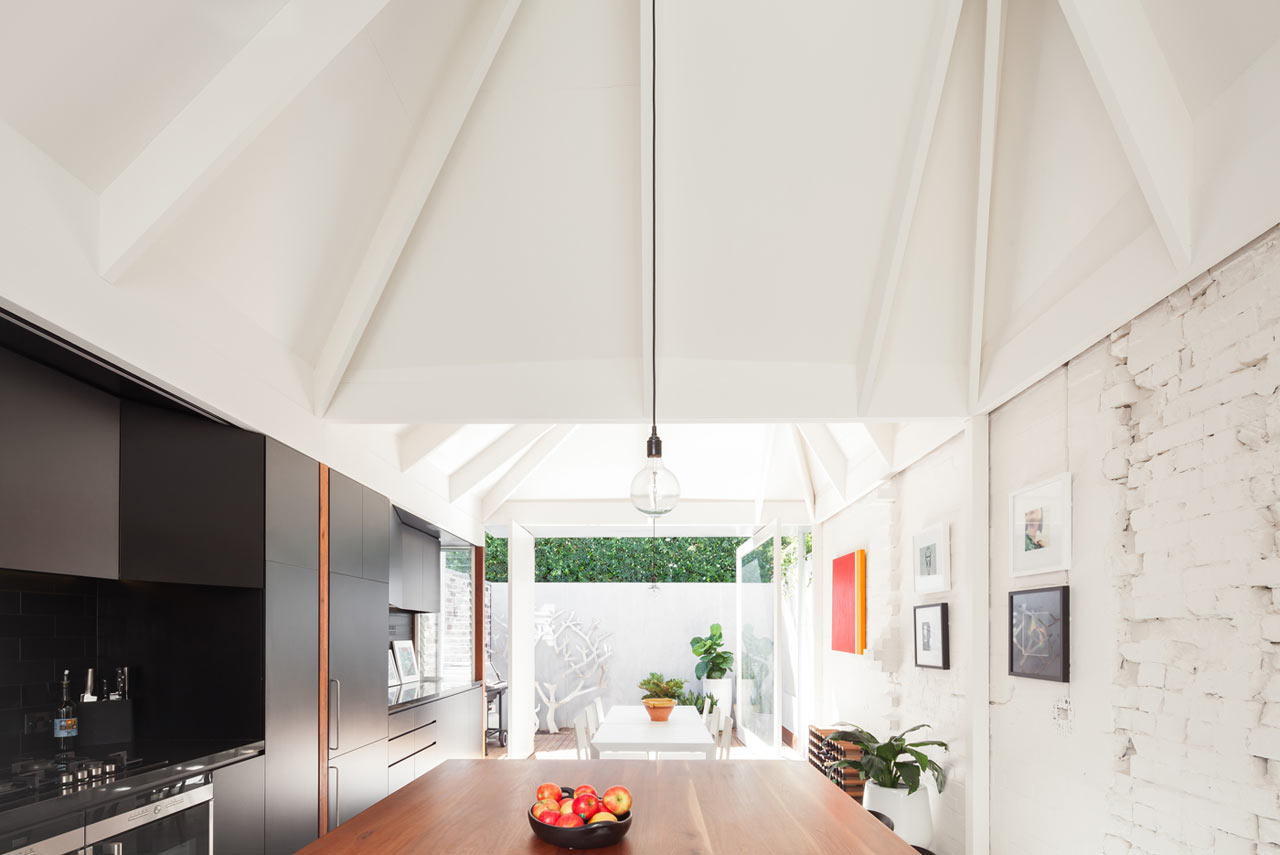 A Dark House in Sydney Gets Tall, Sculpted Roof Forms