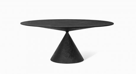 A Table That Balances One Volume on Top of Another