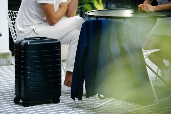 away-travel-luggage-navy-courtyard
