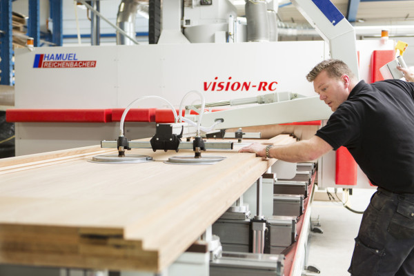Worker prepares table for CNC milling
