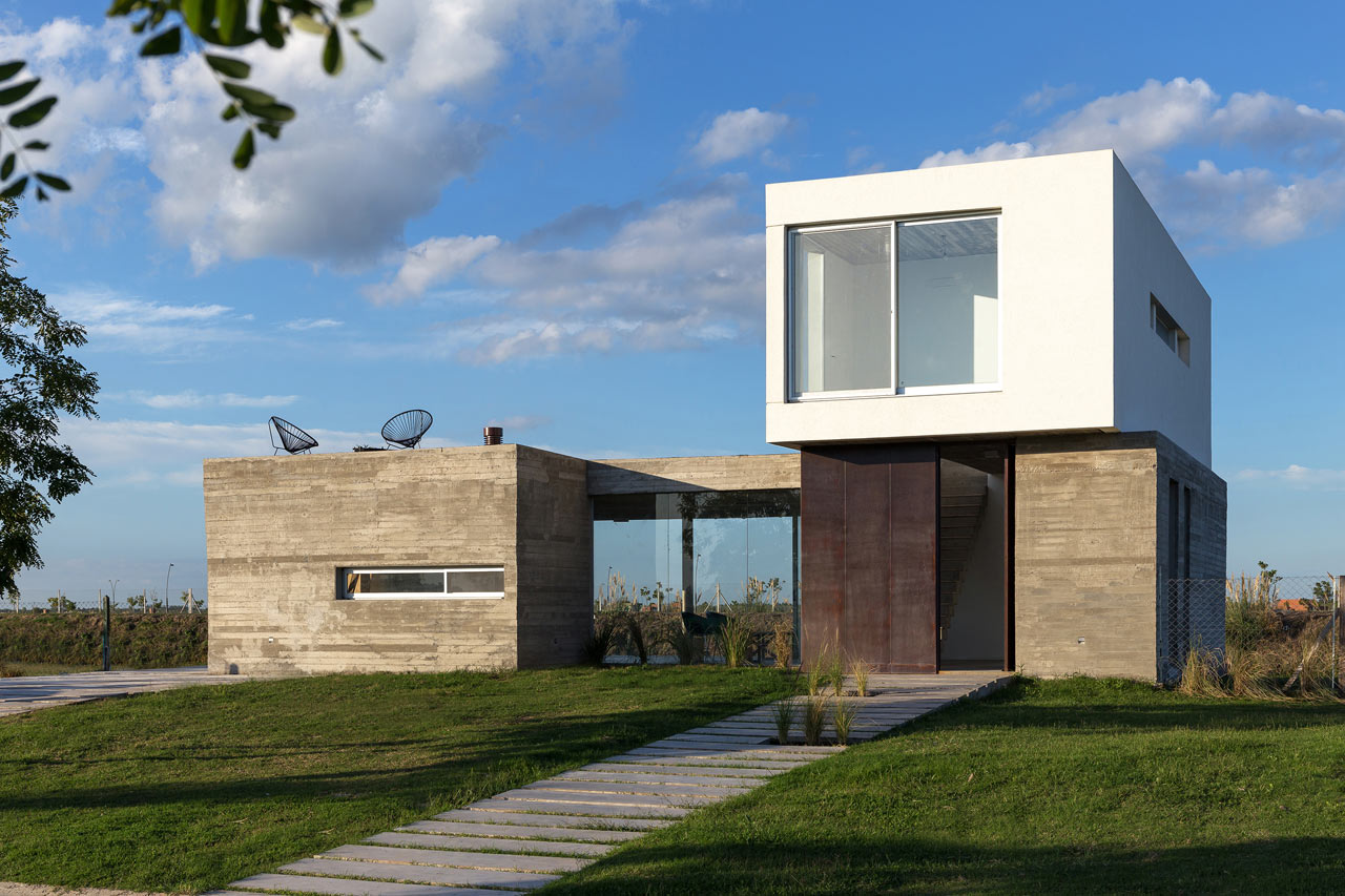 A sustainable house built on a lagoon design milk for Sustainable home design