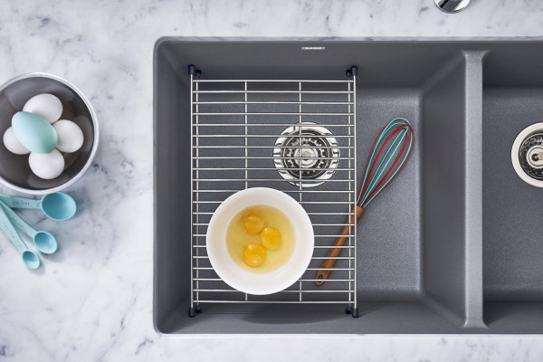 "BLANCO Stainless Steel Floating Grids add an extra layer for holding heavy kitchen items in the sink while washing sitting approximately 4-5"" off the sink bottom."