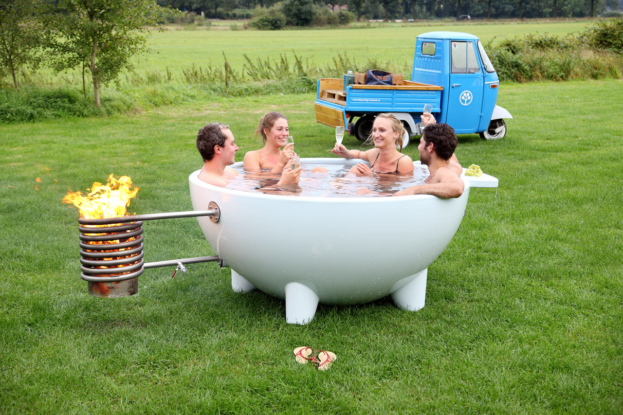 Dutchtub mobile wood burning outdoor hot tub design milk for Outdoor bathtub wood fired