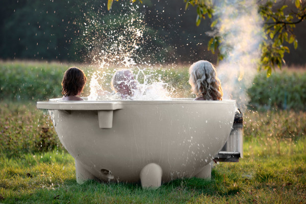 dutchtub mobile wood burning outdoor hot tub design milk. Black Bedroom Furniture Sets. Home Design Ideas