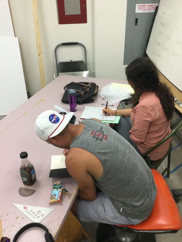 Clinton Motley (front) and Caselle Reinke (back) during the drawing exercise.