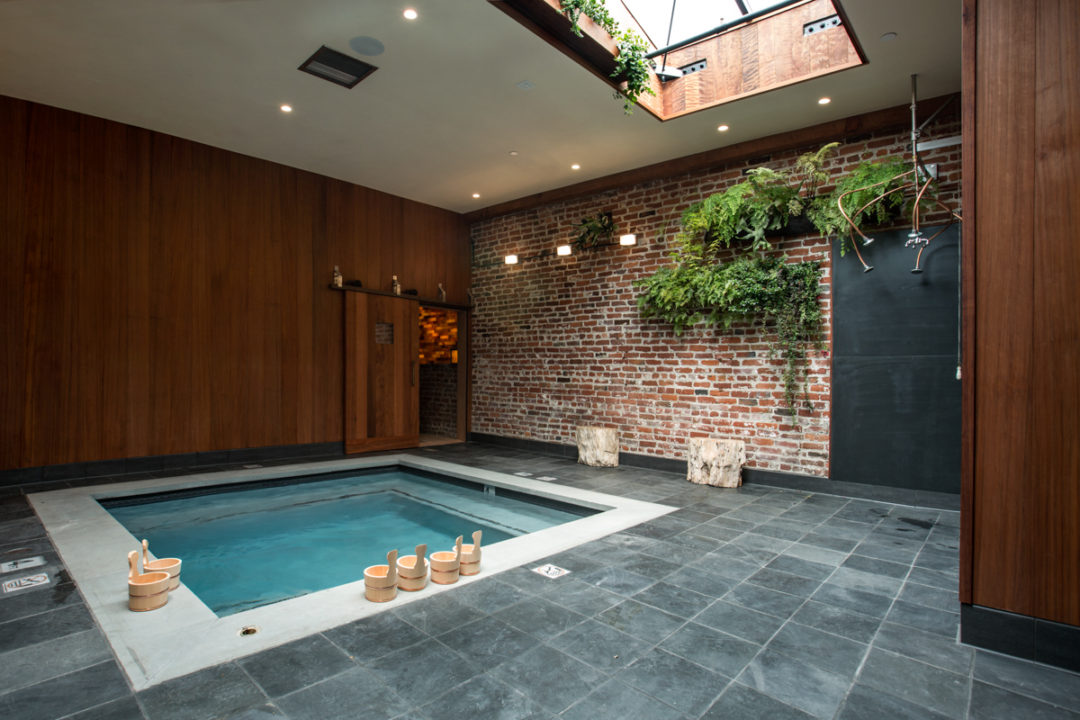 Former auto body shop transformed into zen bathhouse for Bath house shop