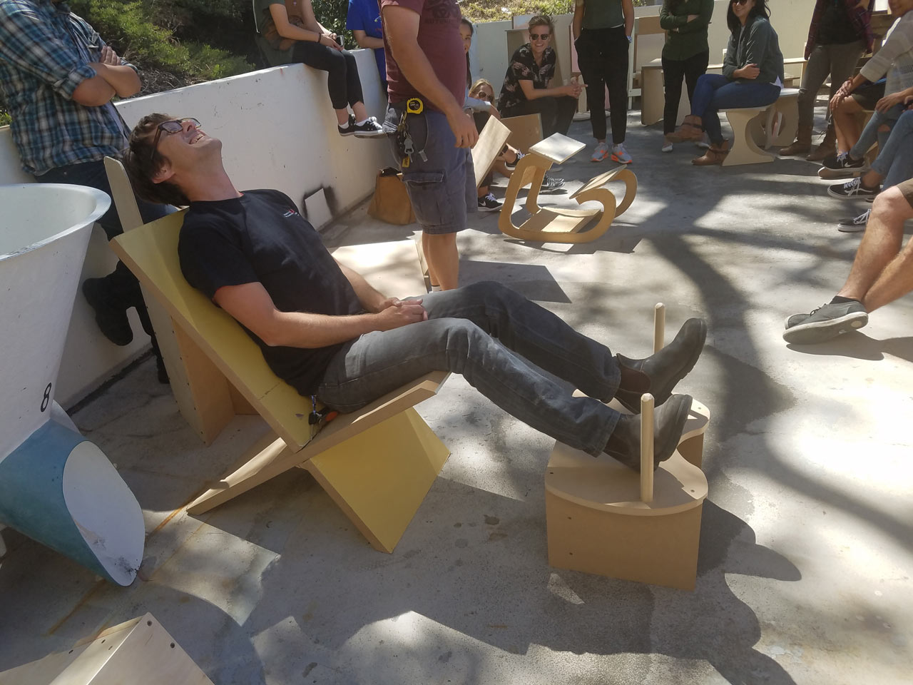 Matthew Hebert enjoying Laila Said's recliner and Chuck Thomson's birthing stool! Photo by Aleya Lanteigne