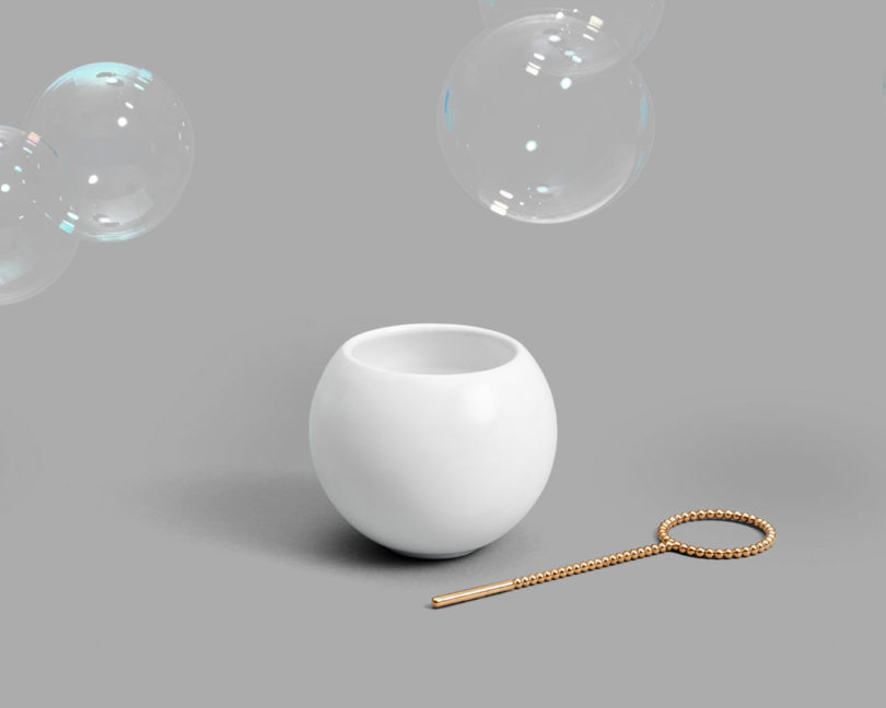 The pattern of small, linked spheres that make up the Bubble Wand emulate the fun of blowing bubbles.