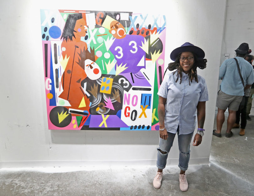 Nina Chanel in front of her painting, Untruth \\\ Courtesy of Getty Images