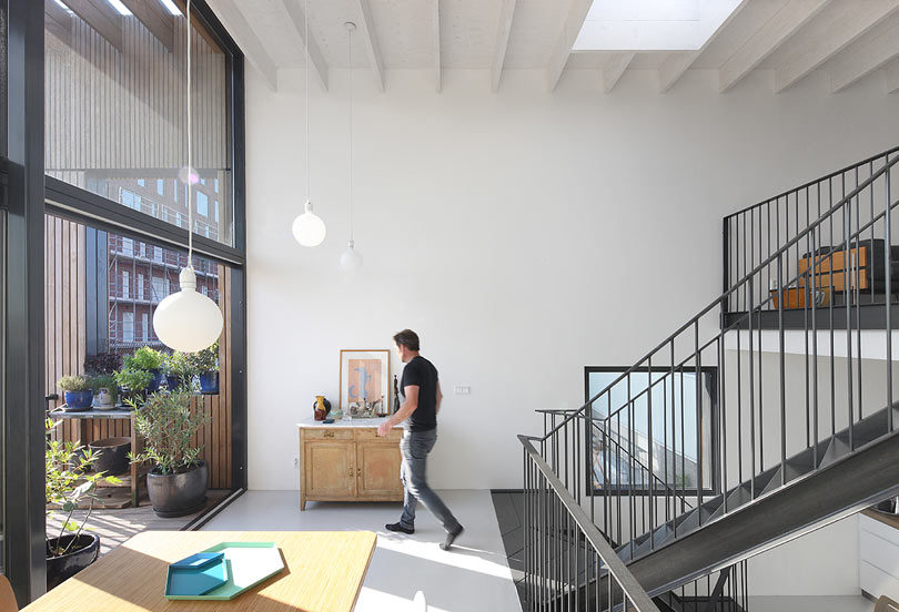 house split in half industrial location inspires this house in amsterdam design milk