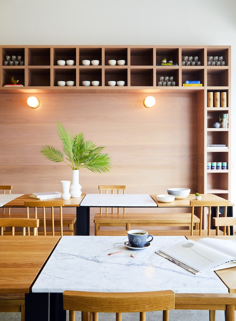 Through design, the restaurant is divided into three separate spaces: the  front-of-house dining, the food pick-up station, and a slower-paced area  for ...