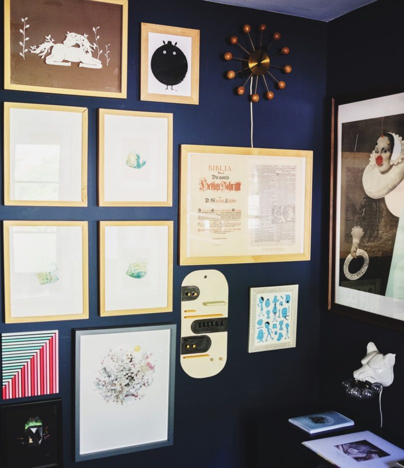 my home office walls display an amalgamation of art prints and frames sourced from a multitude of places collected over the years