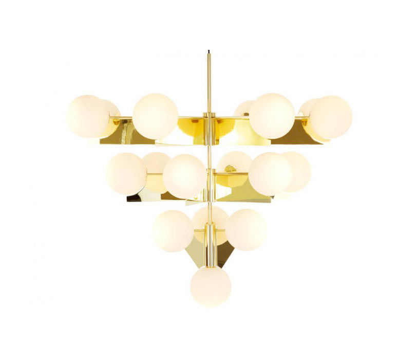 Stunning A brass plated chandelier that us spread over four tiers that hold double layered white glass spheres resulting in a glam statement piece