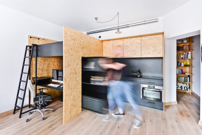 They Used OSB (oriented Strand Board) To Create A Box That Would Serve  Multiple Functions U2013 A Kitchen, Bedroom, Office, And Hidden Kidu0027s Room.
