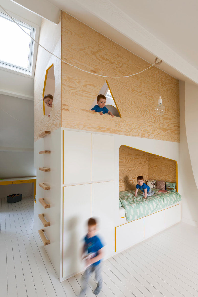 In The Middle Of Room A Large Volume Houses Bed On Each Side Giving Two Kids Their Own Bedroom With Incorporated Storage