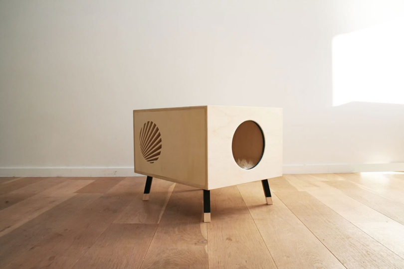 After months at the drawing board, the two came up with Nest, minimal  modules that cats can call their very own. Cats can hide within the plywood  boxes to ...