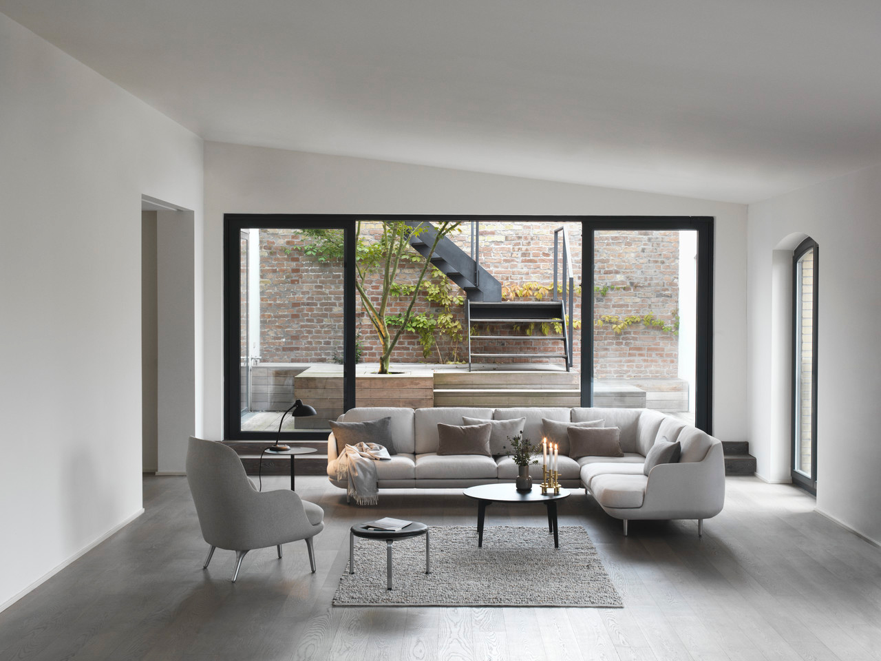 Fritz Hansen Introduces Lune – A Sofa by Jaime Hayon