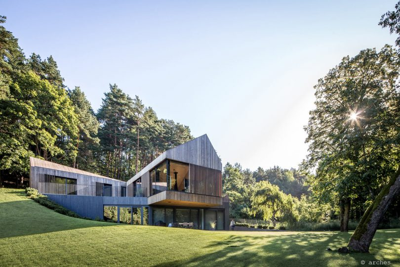 A Pine-Clad Villa Built into a Slope in Lithuania