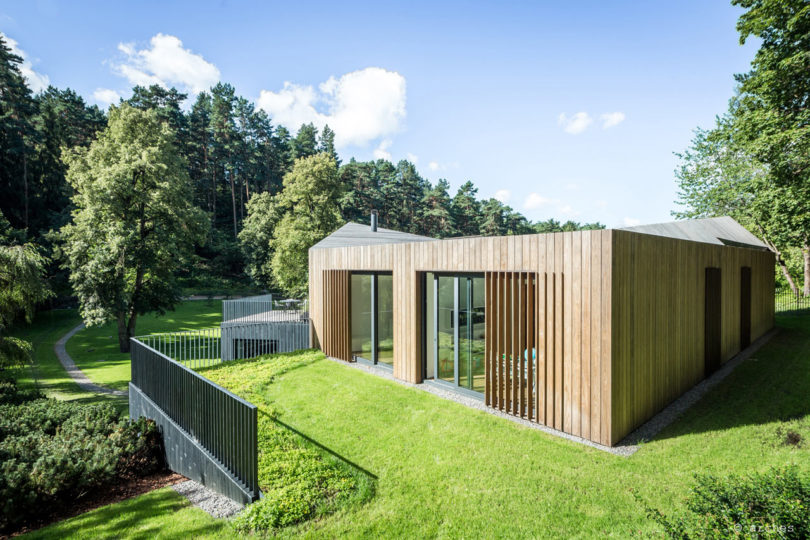 Helping It Blend Into Its Wooded Surroundings, The House Is Clad In Pine  That Will Naturally Gray Over Time. The Pine Boards Were Installed  Vertically ...