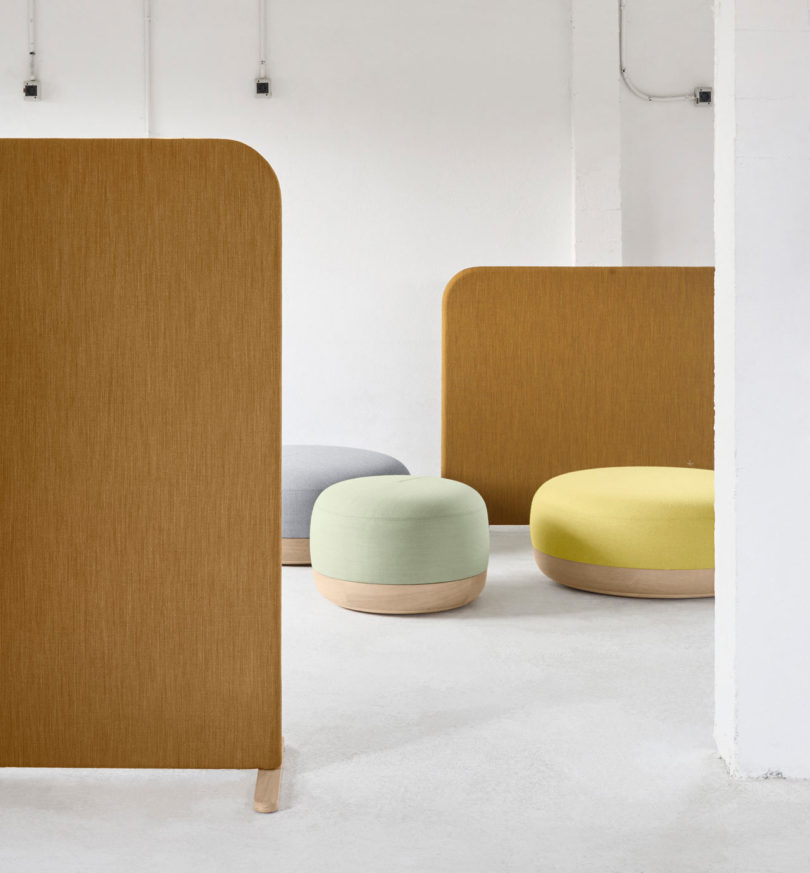 A Series Of Three Curvy Poufs That Combine Wooden Bases With Comfy  Upholstered Seats.