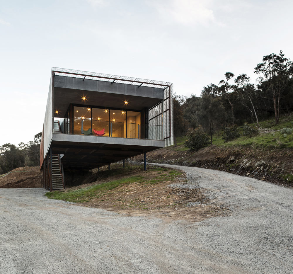 A long narrow house nestled into the side of mount for Long narrow house designs